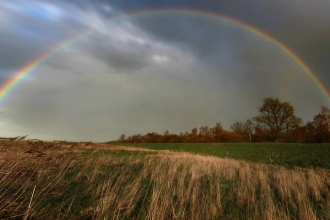 Rainbow over the Great Fen by Guy Pilkington