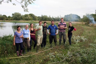 Happy volunteers from BGL Group help to remove willow from Irthlingborough in Sept 2013