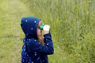 Emma takes a closer look at Woodwalton Fen through her binoculars