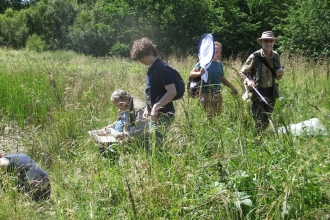 Expert recorders and young naturalists conducting a bioblitz in Fineshade