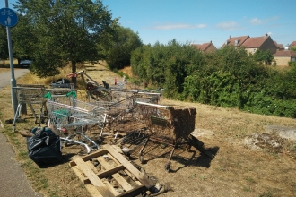 A pile of rubbish cleared from Renhold Brook, including pallets and trollies