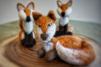 Three hand-crafted felt foxes by Blossom Felts