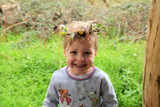 Child with nature crown