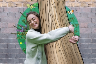 A woman hugging an illustrated tree
