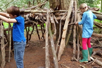 Boy and girl den building