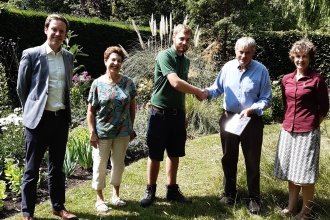 Wildlife Gardening Judge Bernard Hunt and Sue Barnard from the Wildlife Trust BCN awarding first prize to Downing College