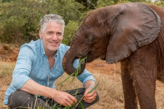 Gordon Buchanan with a baby elephant