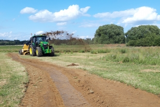 Rotary ditcher at work in the Nene Valley with ditch in foreground