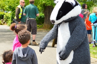 children meeting badger at Wildlife Day