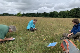 Interns and volunteers conducting a grassland survey at Trumpington Meadows