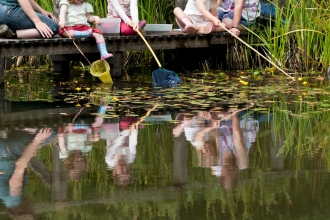 Pond-dipping with nets and wellies