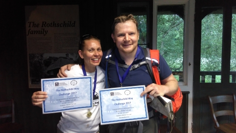 Two participants of the Rothschild Way Challenge 2017 hold up their certificates