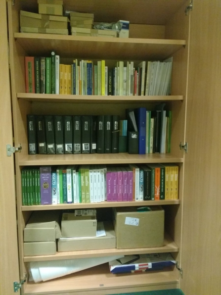The WILDside resources cupboard, full of books and equipment