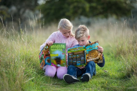 Children reading Wildlife Watch magazine